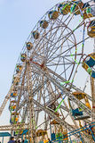 People enjoy the big wheel in the amusement park in Delhi in fro Stock Photo