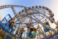 People enjoy the big wheel in the amusement park in Delhi in fro Royalty Free Stock Images