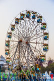 People enjoy the big wheel in the amusement park in Delhi in fro Stock Photos