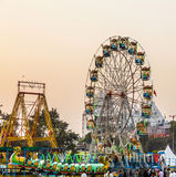 People enjoy the big wheel in the amusement park in Delhi Stock Image