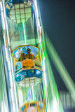People enjoy the big wheel in the amusement park in Delhi Stock Photo