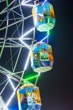 People enjoy the big wheel in the amusement park in Delhi Stock Photo