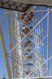 People enjoy the big wheel at the festival Stock Photo
