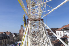 People enjoy the big wheel at the festival. GELNHAUSEN, GERMANY - MARCH 9. people enjoy the 24th Barbarossamarkt festival with big wheel on March 9, 2014 in royalty free stock photo