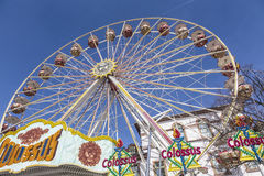 People enjoy the big wheel at the festival Stock Photos