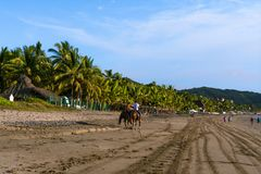 People enjoy Boquita beach in Manzanillo Colima. stock images