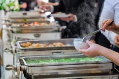 The people are enjoy buffet. With blurred background royalty free stock photography