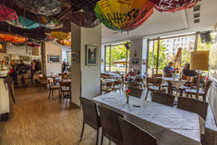 People enjoy cafe at the cafe Sybille. BERLIN, GERMANY - MAY 1, 2015: people enjoy cafe at the cafe Sybille. The cafe has still the socialist charme of the east royalty free stock image