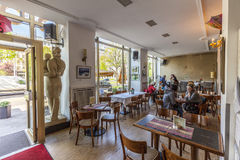 People enjoy cafe at the cafe Sybille. BERLIN, GERMANY - MAY 1, 2015: people enjoy cafe at the cafe Sybille. The cafe has still the socialist charme of the east royalty free stock photo
