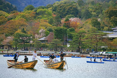 People enjoy cherry blossom on boats in Arashiyama. ARASHIYAMA-APR 17: Unidentified people enjoy cherry blossom party, called Hanami, by floating on boats on royalty free stock photography