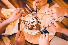 People enjoy chocolate Bingsu on tray, Bingsu or Bingsoo. Korean shaved ice dessert with sweet toppings and fruit and varieties with ingredients, popular stock images