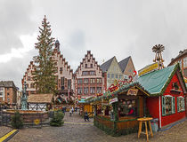 People enjoy the christmas market at the Roemer Stock Image
