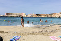 People enjoy the clear beach at paradise bay lido in Valetta. VALETTA, MALTA - SEP 23, 2012: people enjoy the clear beach at paradise bay lido in Valetta, Malta royalty free stock image