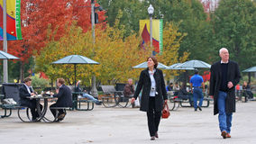 People enjoy colorful autumn tree leaves at Millennium park Stock Photo