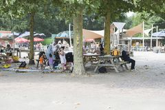People enjoy drinks and food at terrace. Hilvarenbeek,Holland,28-07-2018:people from different cultures enjoy a snack and drink on the terrace of the amusement royalty free stock photography