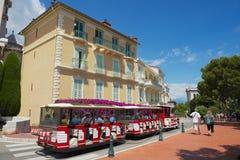 People enjoy excursion with the sightseeing train in Monaco, Monaco. Royalty Free Stock Photo