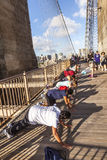 People enjoy exercises at Brooklyn Bridge in New York Royalty Free Stock Images