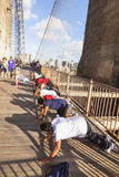 People enjoy exercises at Brooklyn Bridge in New York Stock Image