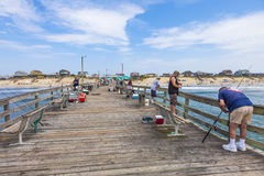 People enjoy fishing at the famous pier Royalty Free Stock Image