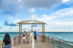 People enjoy the Fishing Pier in Sunny Isles Beach Stock Photography