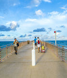 People enjoy the Fishing Pier in Sunny Isles Beach Royalty Free Stock Image