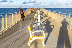 People enjoy the Fishing Pier in Sunny Isles Beach Royalty Free Stock Photos