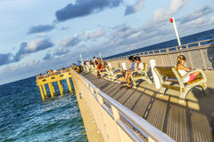 People enjoy the Fishing Pier in Sunny Isles Beach. SUNNY ISLES BEACH, USA - AUG 1, 2013: people enjoy the Fishing Pier in Sunny Isles Beach , Florida. It is the Royalty Free Stock Photo
