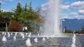 People enjoy and have fun in the fountain stock footage
