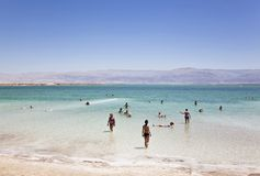 People enjoy the healing waters of the Dead sea Stock Photos