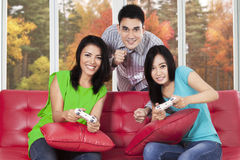 People enjoy holiday by playing video games Stock Photos