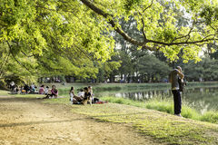 People enjoy a hot day in Ibirapuera Park. Ibirapuera Park is the largest park in Sao Paulo, Brazil royalty free stock photo