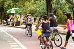 People enjoy a hot day in Ibirapuera Park in Sao Paulo, Brazil.  stock images