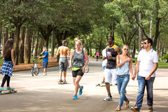 People enjoy a hot day in Ibirapuera Park in Sao Paulo, Brazil Royalty Free Stock Photography