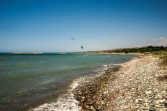 People enjoy kitesurfing rides on Aluminos beach near Larnaca Stock Photography
