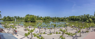 People enjoy the lake in Bad Nauheim. BAD NAUHEIM, GERMANY - JUNE 4, 2015: people enjoy the lake in Bad Nauheim, Germany. The area was created by architect stock image