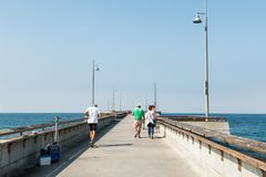 People Enjoy Leisure Activities on the Venice Beach Fishing Pier Stock Photos