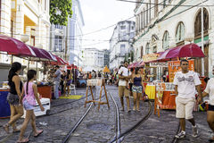 People enjoy a local market on the street in the downtown of Recife, Pernambuco Stock Photos