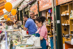 People enjoy the Naschmarket in Vienna. VIENNA, AUSTRIA - APR 28, 2015: people enjoy the Naschmarket in Vienna. Since the 16th century people in Austria has come royalty free stock photography