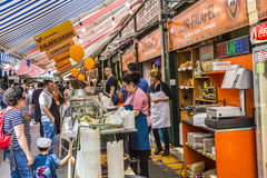 People enjoy the Naschmarket in Vienna. VIENNA, AUSTRIA - APR 28, 2015: people enjoy the Naschmarket in Vienna. Since the 16th century people in Austria has come royalty free stock image
