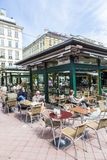People enjoy the Naschmarket in Vienna. VIENNA, AUSTRIA - APR 28, 2015: people enjoy the Naschmarket in Vienna. Since the 16th century people in Austria has come royalty free stock photos