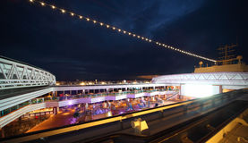 People enjoy night party on deck of cruise ship. People enjoy night party on the deck of illuminated cruise ship Royalty Free Stock Photo