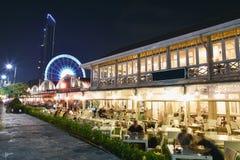 Enjoy the night. People enjoy they night time in public restaurant Stock Photos