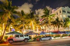 People enjoy nightlive at ocean Stock Photography
