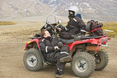 People enjoy off-road vehicle excursion in Longyearbyen, Norway. Royalty Free Stock Photo