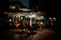 People enjoy outdoor dining in London. People enjoy dinner in an outdoor restaurant near  Covent Garden in London on October 4, 2013. The Covent Garden area has Stock Photo