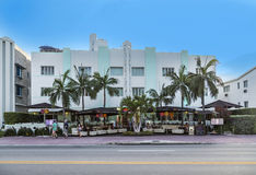 People enjoy the outdoor restaurant at the art deco Hotel the Do Stock Photo
