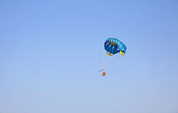 People enjoy paragliding in the sky stock images