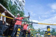 People enjoy playing archery. Selangor, Malaysia - October 31, 2015 – People enjoy playing archery in carnival open day in summer Royalty Free Stock Photos