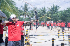 People enjoy playing archery. Selangor, Malaysia - October 31, 2015 – People enjoy playing archery in carnival open day in summer Stock Photos