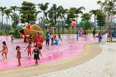 People enjoy playing new waterpark open in Kanchanaburi province, Thailand. Kanchanaburi, Thailand - March 30, 2016: People enjoy playing new waterpark open in stock photography